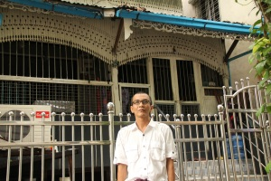 Nyi Nyi Aung outside of a childhood home in Yangon in July, 2013.