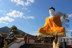 A large Buddha sits at the top a hill in Piang Luang township. Shan New Year's is celebrated on the hillside below it, and the Thailand-Myanmar border is a few hundred yards beyond it.